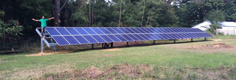Man next to solar panels